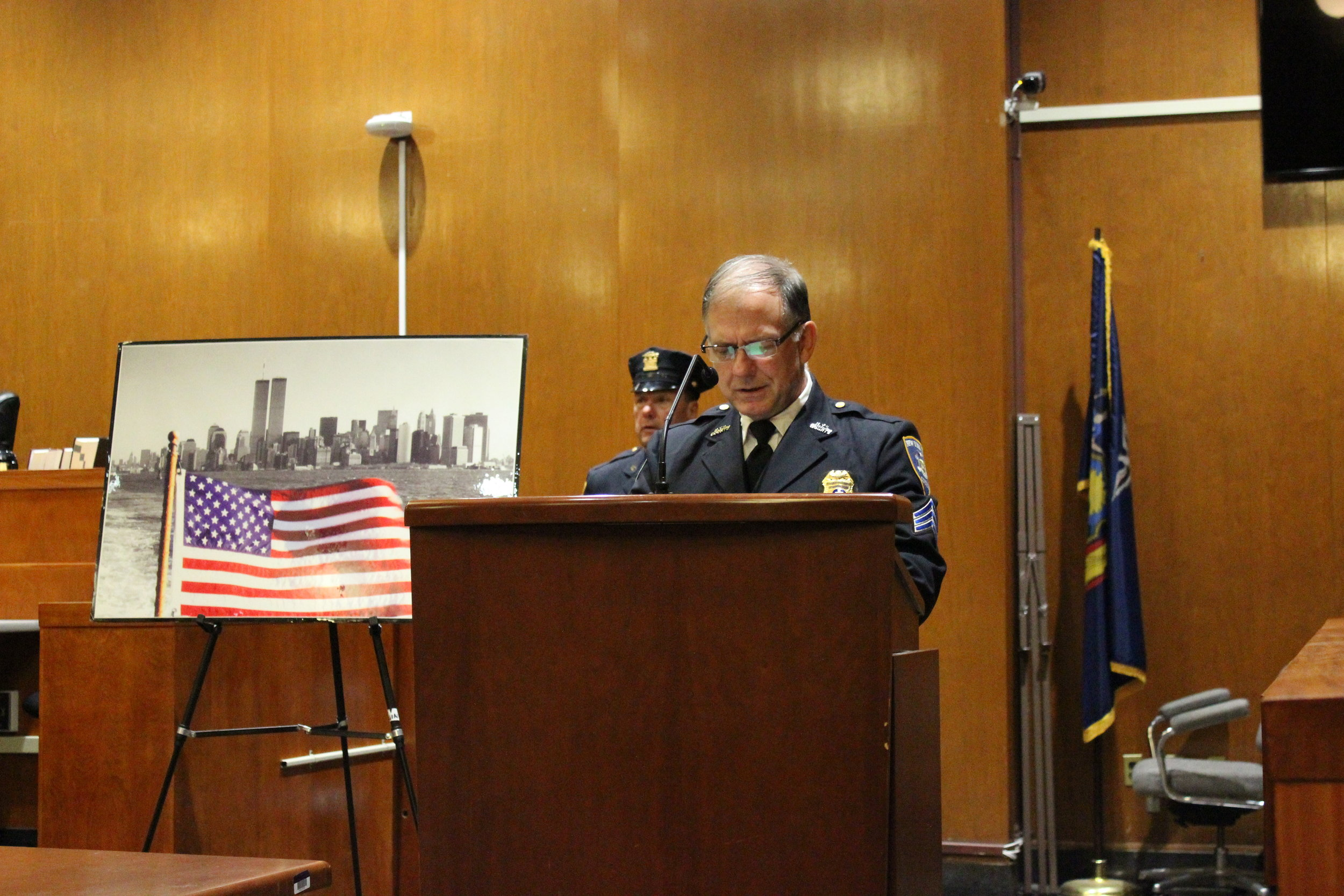 Retired Sgt. Frank Barry addresses the crowd as a chaplain in the Fraternal Order of Court Officers.  Eagle  photos by Victoria Merlino.