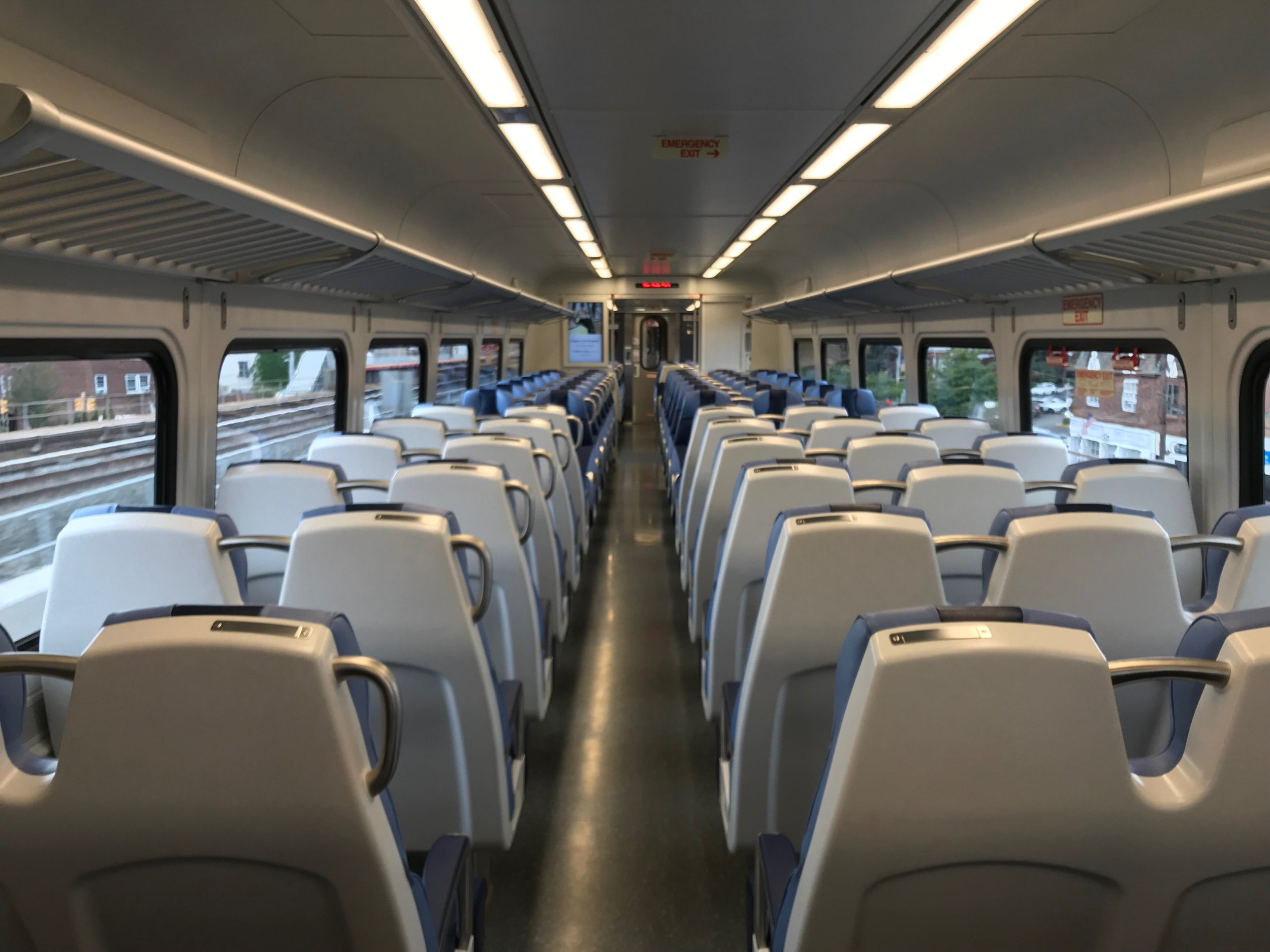 The new M9 cars feature wider seats, additional seating and electrical outlets on both sides of the car in every seat row. Photo via the LIRR.