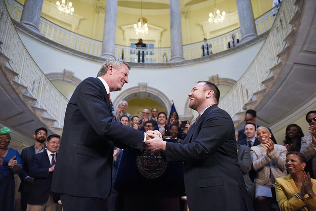 Mayor Bill de Blasio and New York City Council Speaker Corey Johnson shake hands on the 2020 budget, announced ahead of schedule on Friday. Photo by Ed Reed/Mayoral Photography Office.