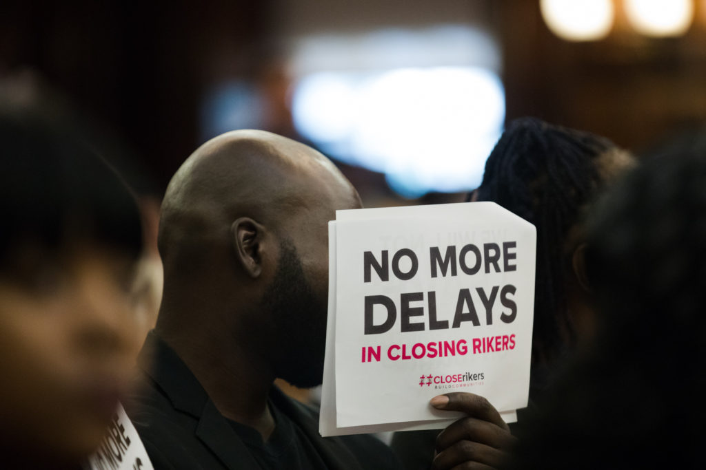 A member of advocacy group Just Leadership USA at the City Council's only public hearing on the borough-based jail plan. Eagle photo by Paul Frangipane.