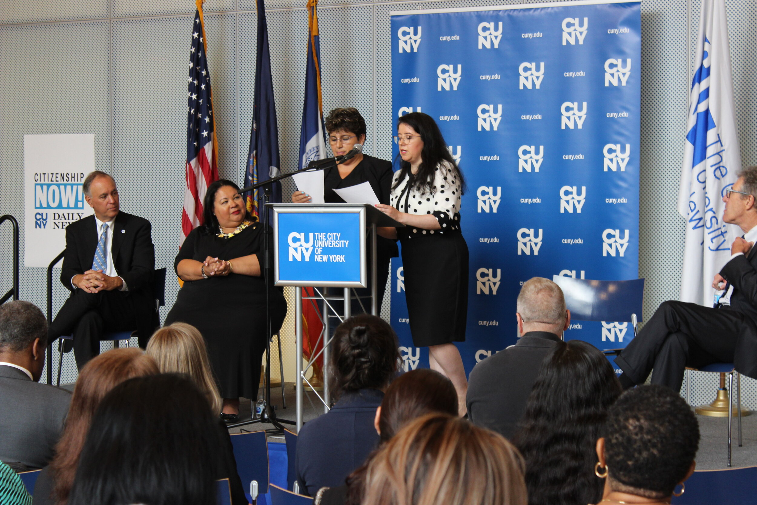 Luzdars Lozar, who became a citizen with help from Citizenship Now!, speaks at a press conference last Friday.