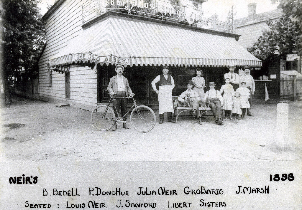 Louis Neir poses with his tavern in 1898.