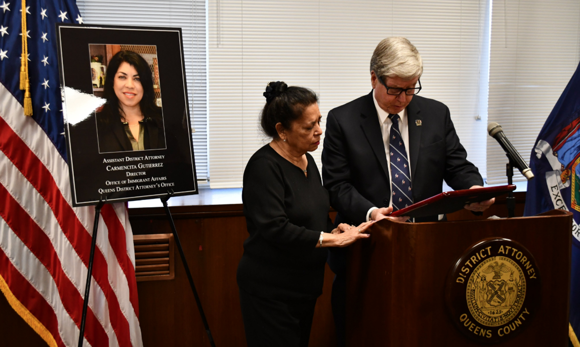 Acting Queens District Attorney John Ryan presenting the 2019 Hispanic Heritage Award to Assistant District Attorney Carmencita Gutierrez's mother. Gutierrez was recovering from an illness and was unable to attend the ceremony. Photo courtesy of the Queens DA's Office
