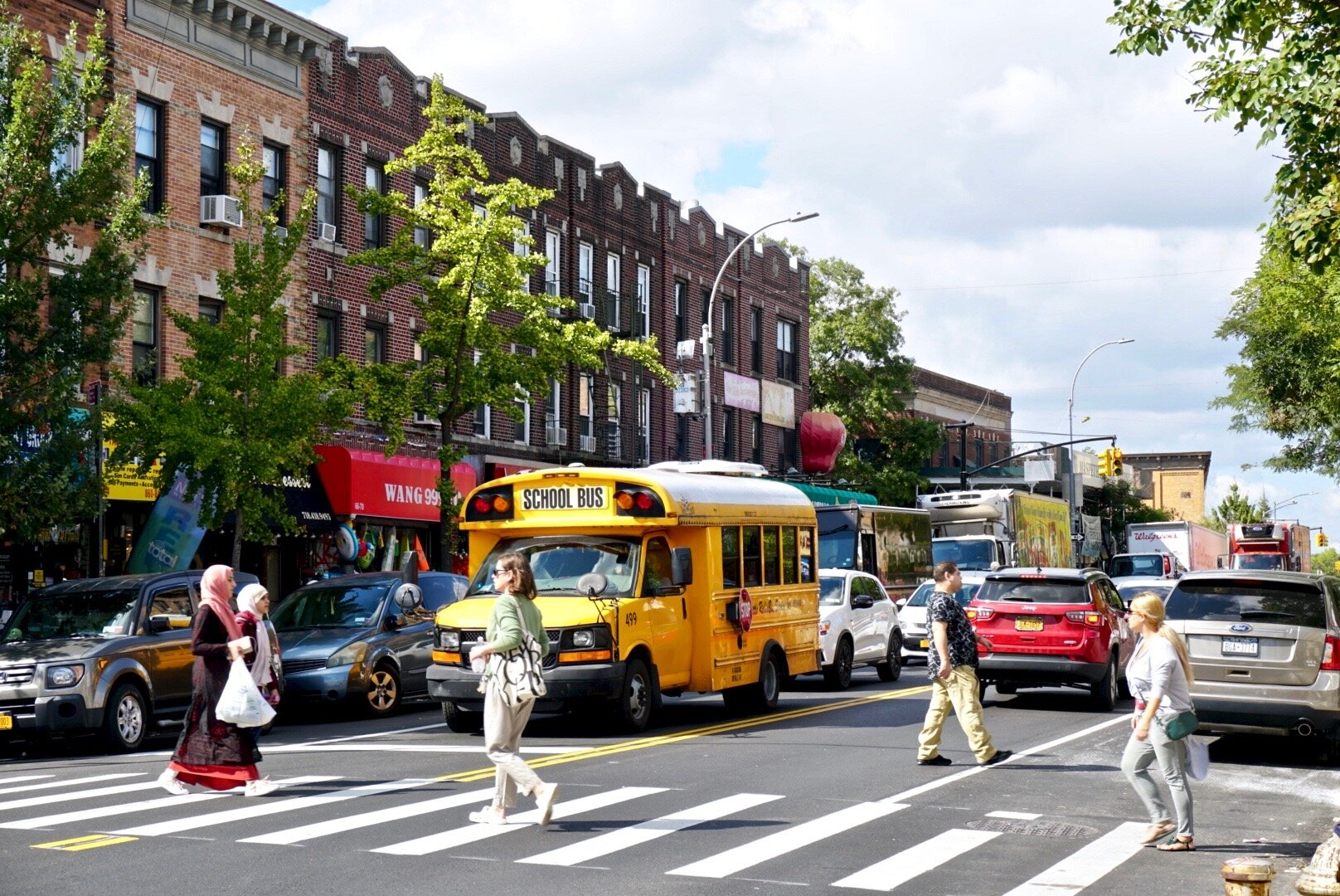 A lawsuit aims to stop the addition of express bus lanes on Fresh Pond Road, a busy commercial thoroughfare in the heart of Middle Village.  Eagle  photo by Luca Powell