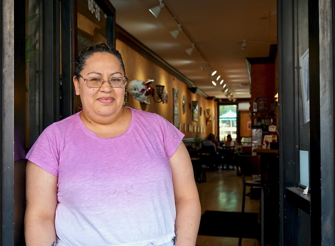 Adriana Rodriguez outside her restaurant. Rodriguez says she's worried about the parking on Fresh Pond Road already.