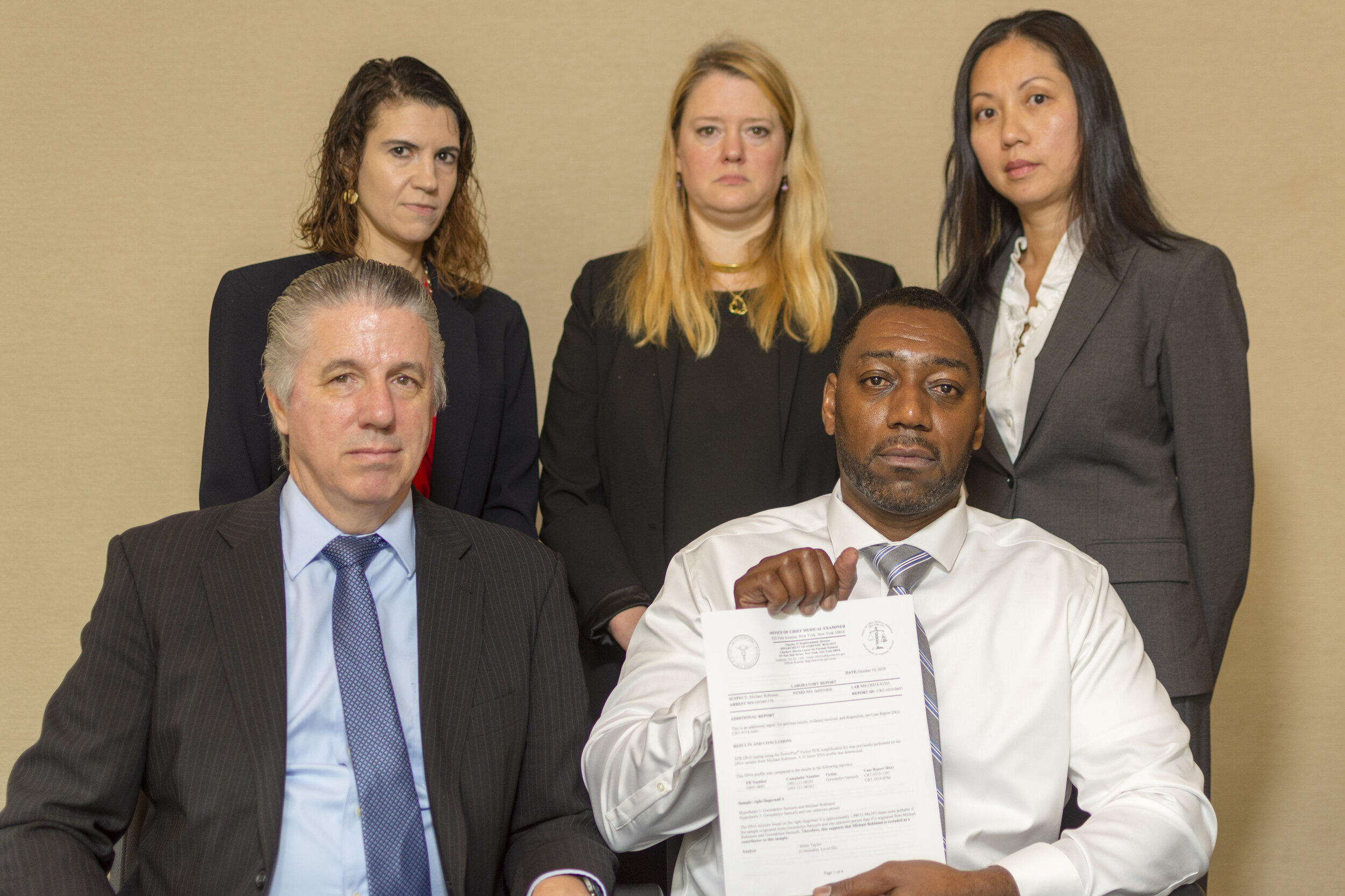 Front row: Legal Aid Criminal Appeals Bureau attorney Harold Ferguson (left) and Michael Robinson. Back row (left to right): Legal Aid DNA Unit attorneys Terri Rosenblatt, Jessica Goldthwaite and Jenny Cheung. Photo courtesy of Legal Aid