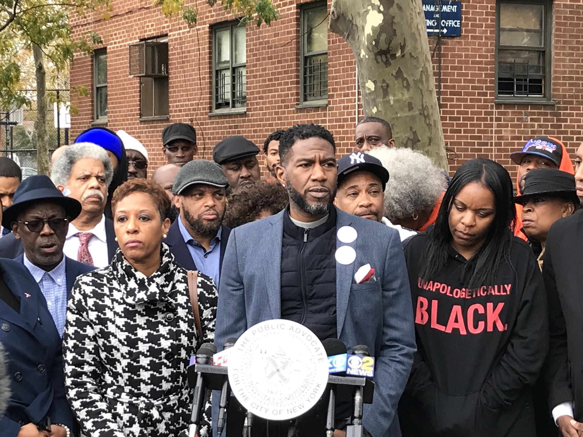 Public advocate Jumaane Williams (right) and Councilmember Adrienne Adams called on the city to invest more money for jobs, education and community programs in Southeast Queens at a press conference outside of the Baisley Park Houses Tuesday. A 14-year-old boy was shot and killed at a nearby basketball court Saturday.  Eagle  photos by David Brand.