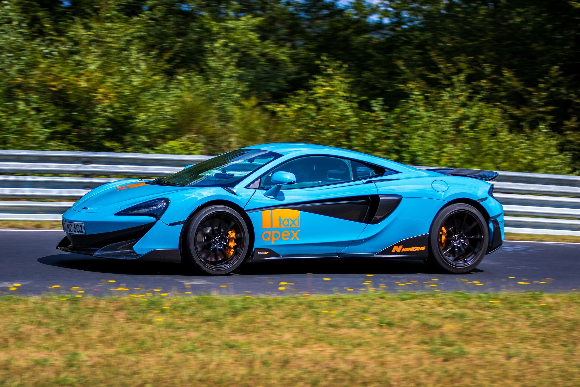 A Flushing man was charged with insurance fraud after allegedly claiming that his light blue McLaren sports car, similar to the one pictured, was stolen. Investigators claim he actually crashed it himself. Photo by Domenik2212 via Pixabay.