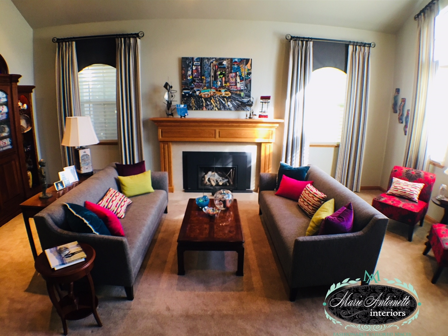 This is one of my favorite projects! An otherwise gray monochromatic room comes alive with bright colored pillows that add life and a sense of drama to my client's living room. Loved by all whom entered, a fun and casual way to enjoy the room!