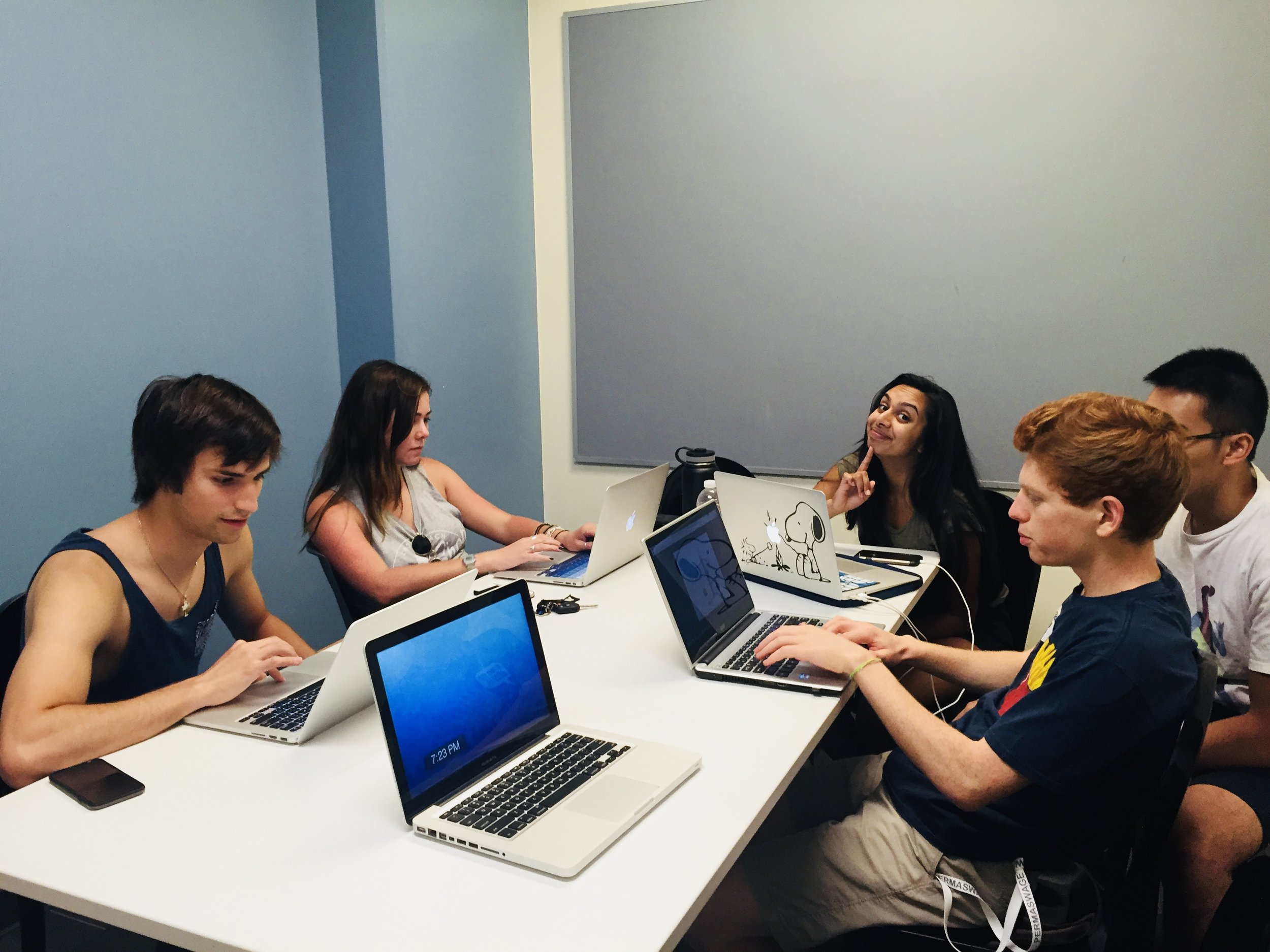 Students meeting on campus during a project meeting.