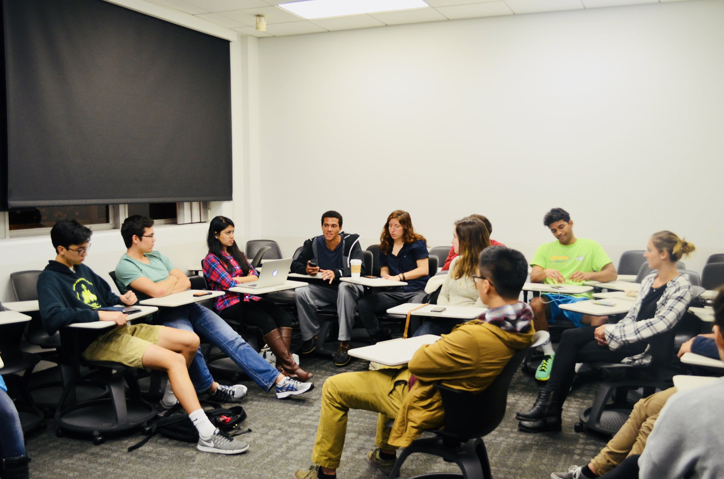 Discussing possible alternatives during a project meeting on campus.