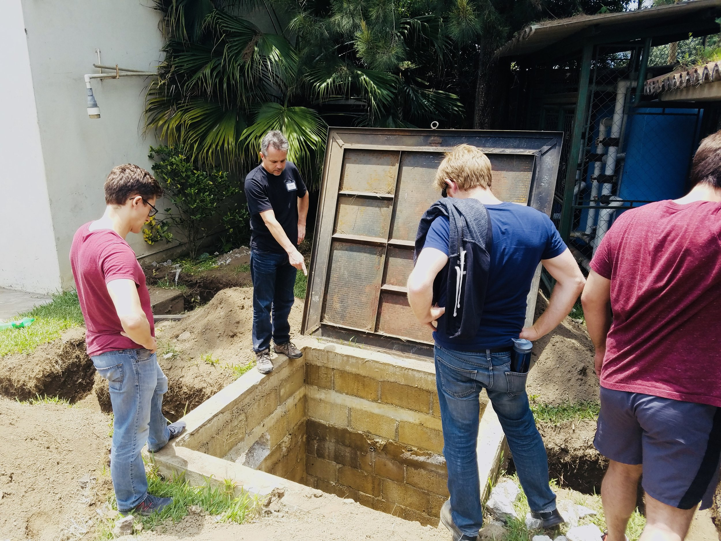 Surveying the water storage system during the 2017 Guatemala Project implementation trip