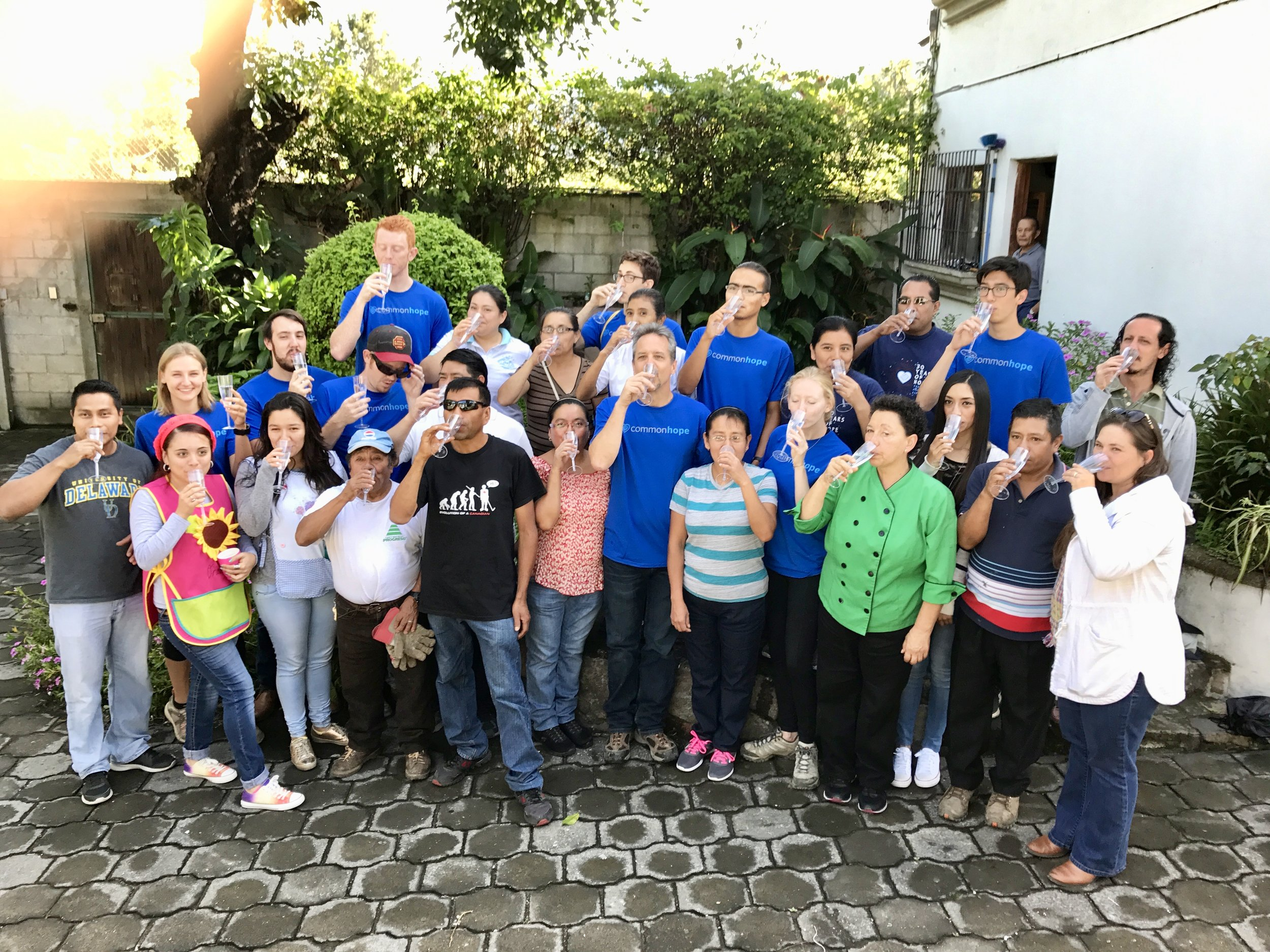 Sampling the newly filtered drinking water at the Common Hope campus during the 2017 Guatemala project implementation trip.