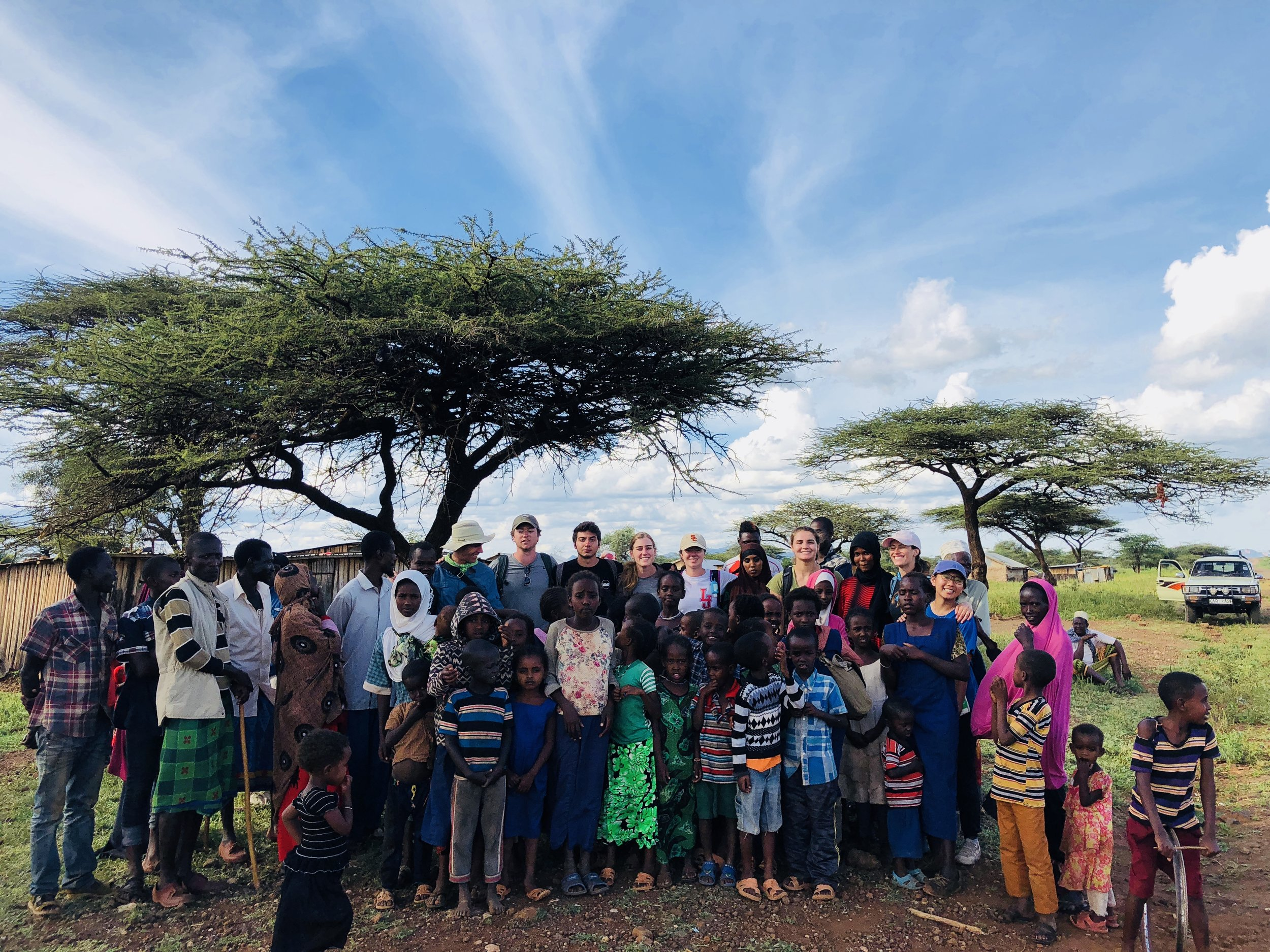 The Kenya project travel team with members of the Gambella community.