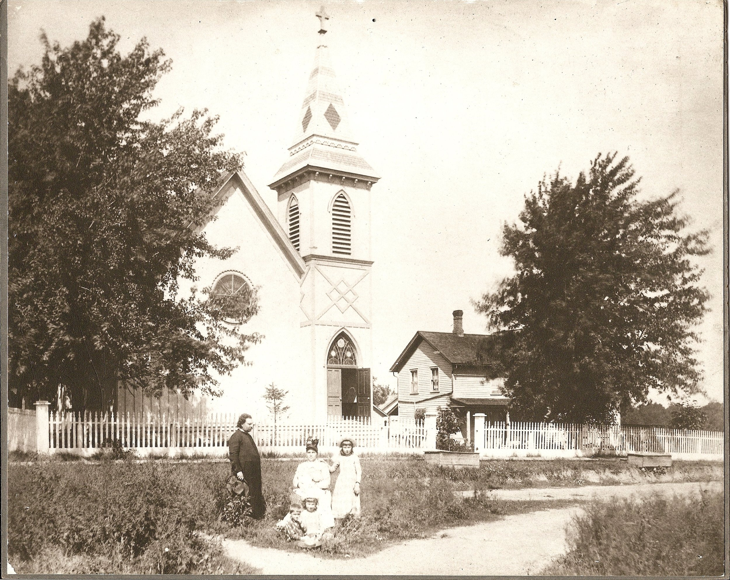 The Rev. Charles Hodge, wife Laura, and children Justin, Charles and Mary (in the lap of Laura) pose in front of Grace Church in this iconic photo from 1900 during Hodge's second term as priest.