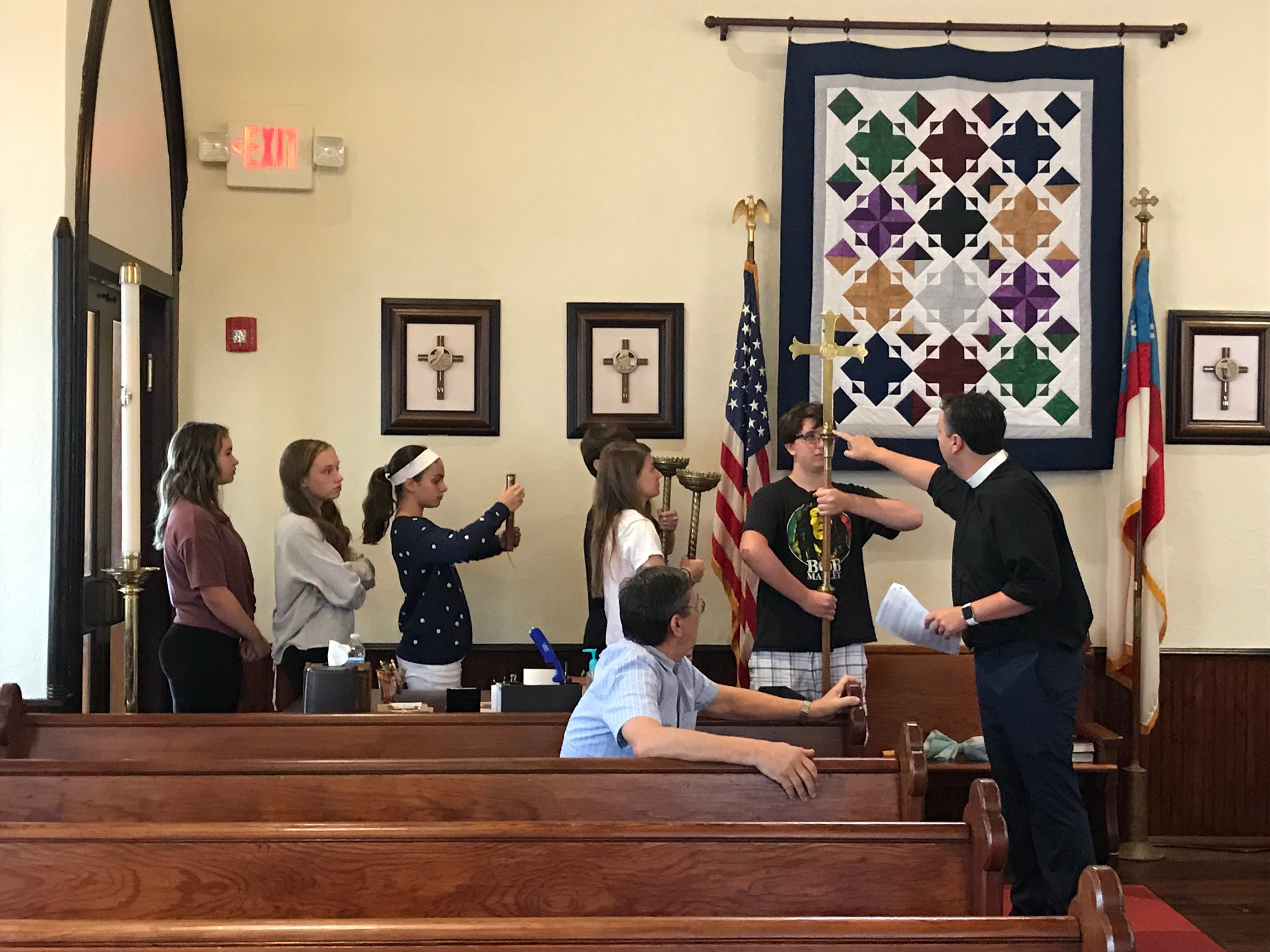 Fr. Greg trains new and veteran acolytes in how to process in worship. August 18, 2019.   Photo by Robyn Flowers.