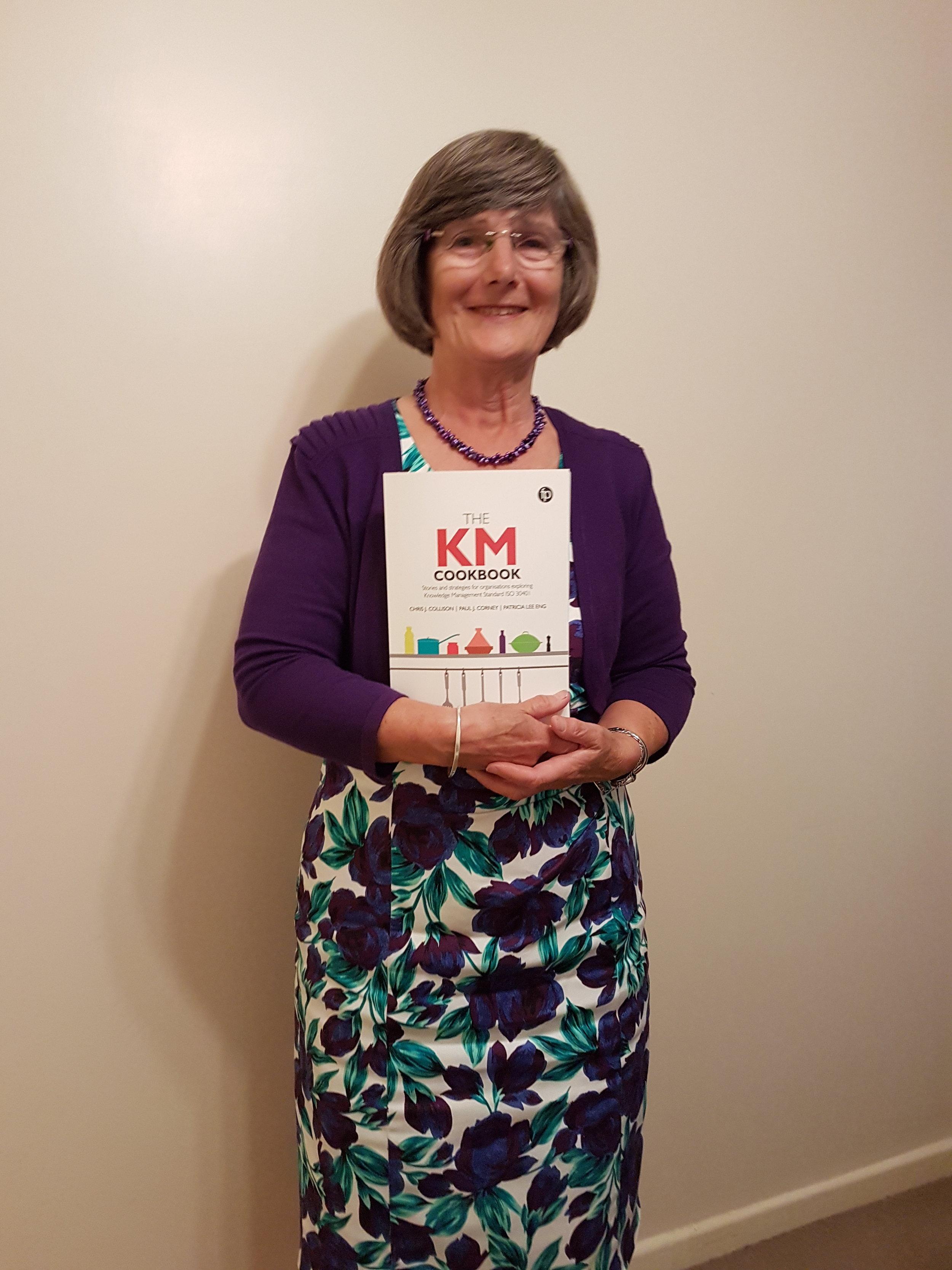 Karen McFarlane, CILIP Trustee, cherishing her copy of the KM Cookbook!