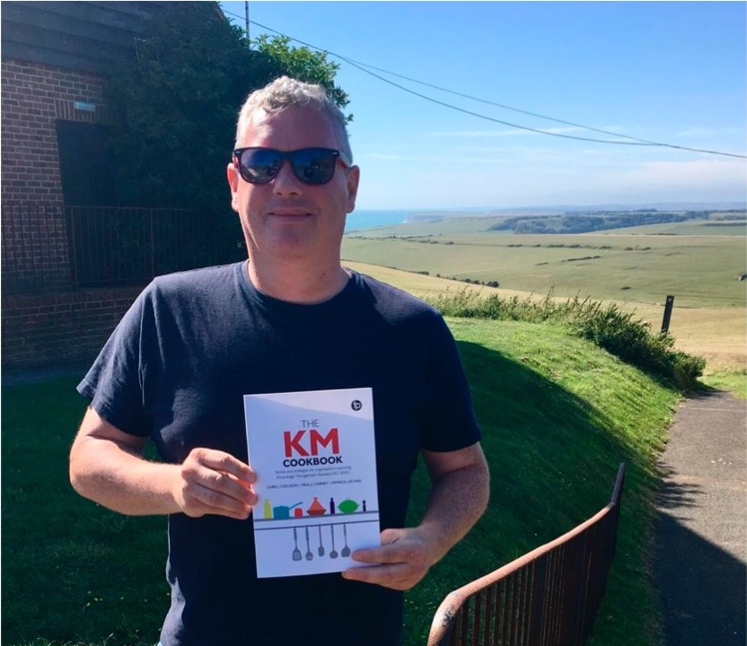 """Ciaran McCann General Manager Vintage Inns with his copy outside of """"The Beachy Head"""""""