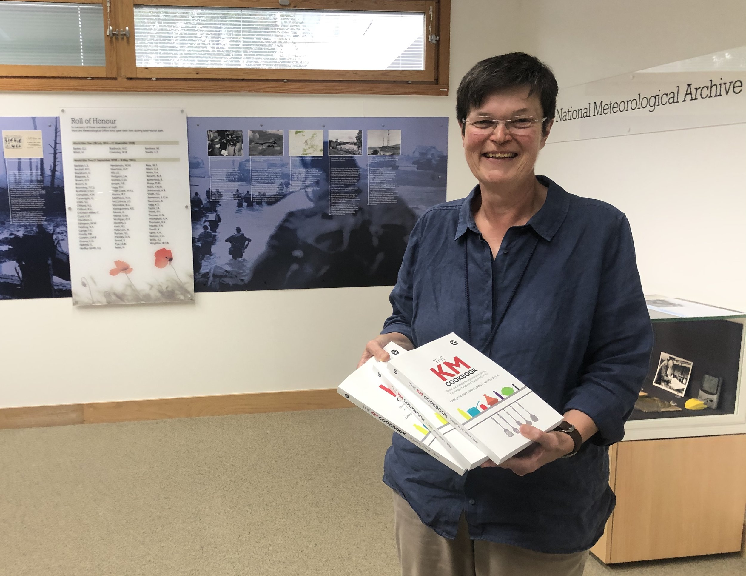 Susan Tucker, Head of Knowledge and Information Management at the UK's Met Office shows off her cookbook copies.