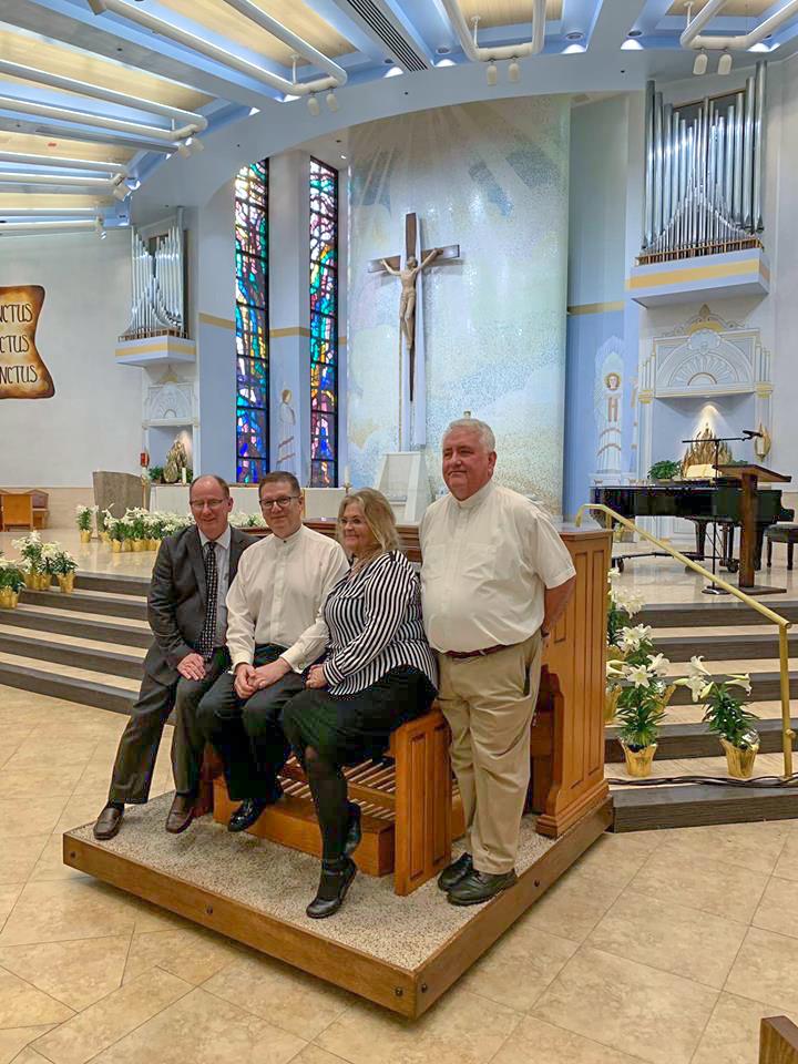 Bob Grant, William Vaughn, Barbara Finn and Father Bob Stoeckig
