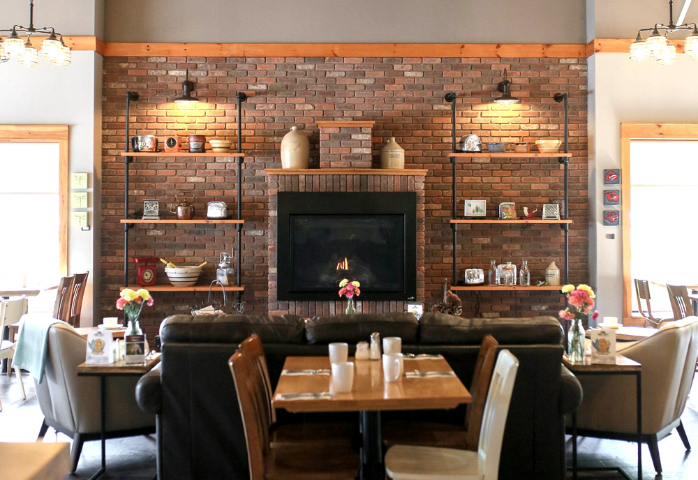 Our fireplace is surrounded by comfy couches and chairs to provide guests with the perfect spot to enjoy breakfast, brunch, or a midday snack.
