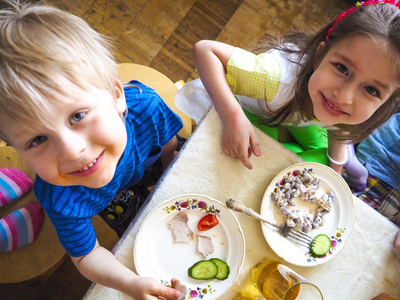 thumbnail_Happy children eating and looking up.jpg