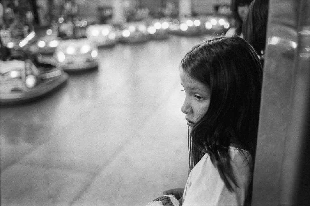 Girl at the bumper cars. Summer, 2011.