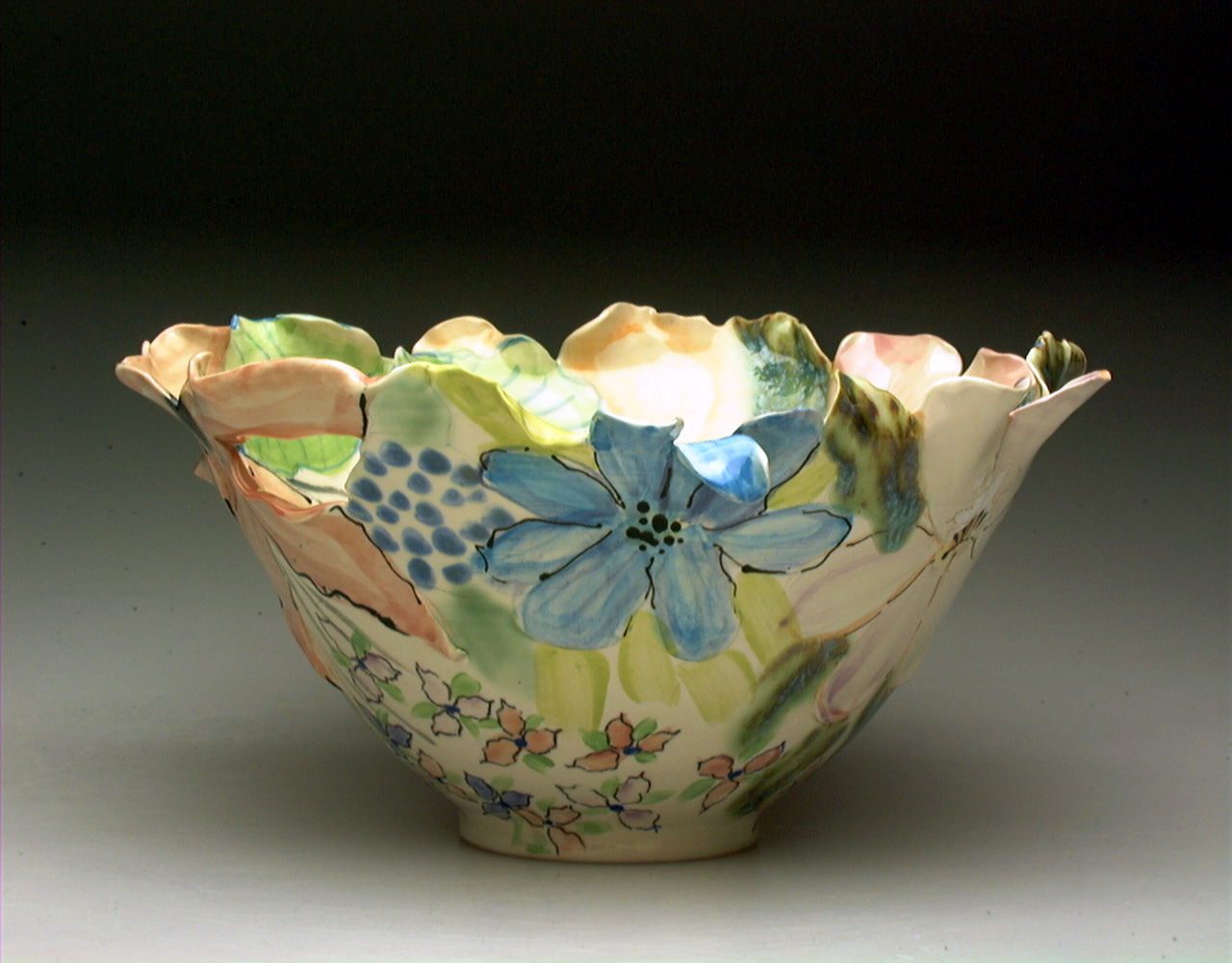Susan Card - Card's ceramic pieces are formed and sculpted, then painted in a watercolour style with glazes and underglazes. Her work acknowledges the tradition of floral symbolism in art that signifies feminine beauty, fertility, and the natural and philosophical worlds, and elevates the everyday to the contemplative.