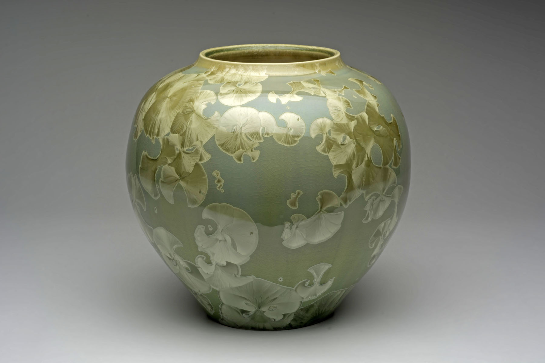 Yumiko Katsuya - Katsuya is fascinated with the natural patterns, mysterious colours, and sense of translucent depth in crystalline glazes. She has a passion for creating functional art, particularly teapots, vases, dishes and Japanese Tea Ceremony utensils.