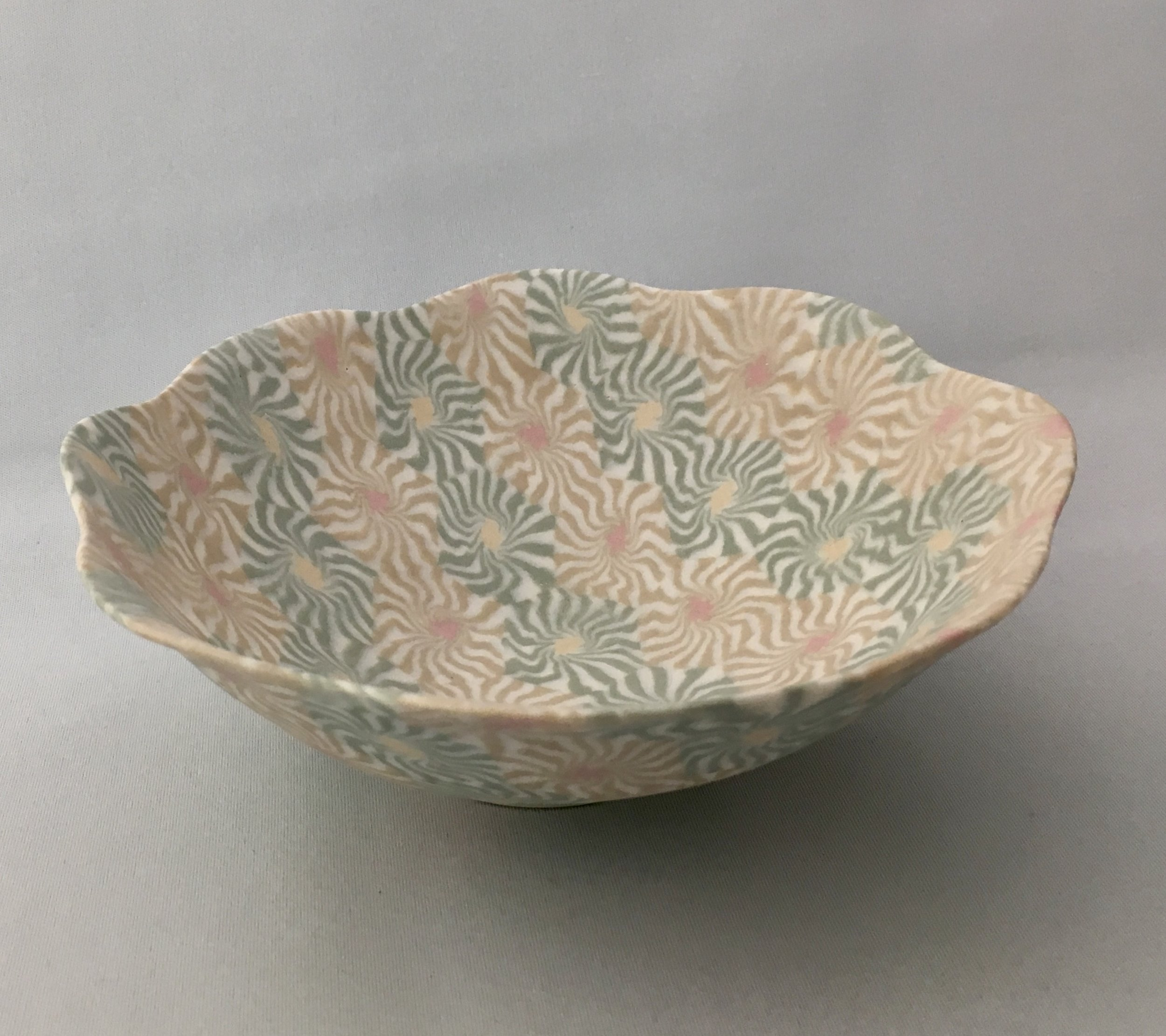 Eiko Maeda - Maeda works in nerikomi, a traditional Japanese hand-building technique that involves stacking, slicing, and re-forming coloured clay to form repeating patterns.
