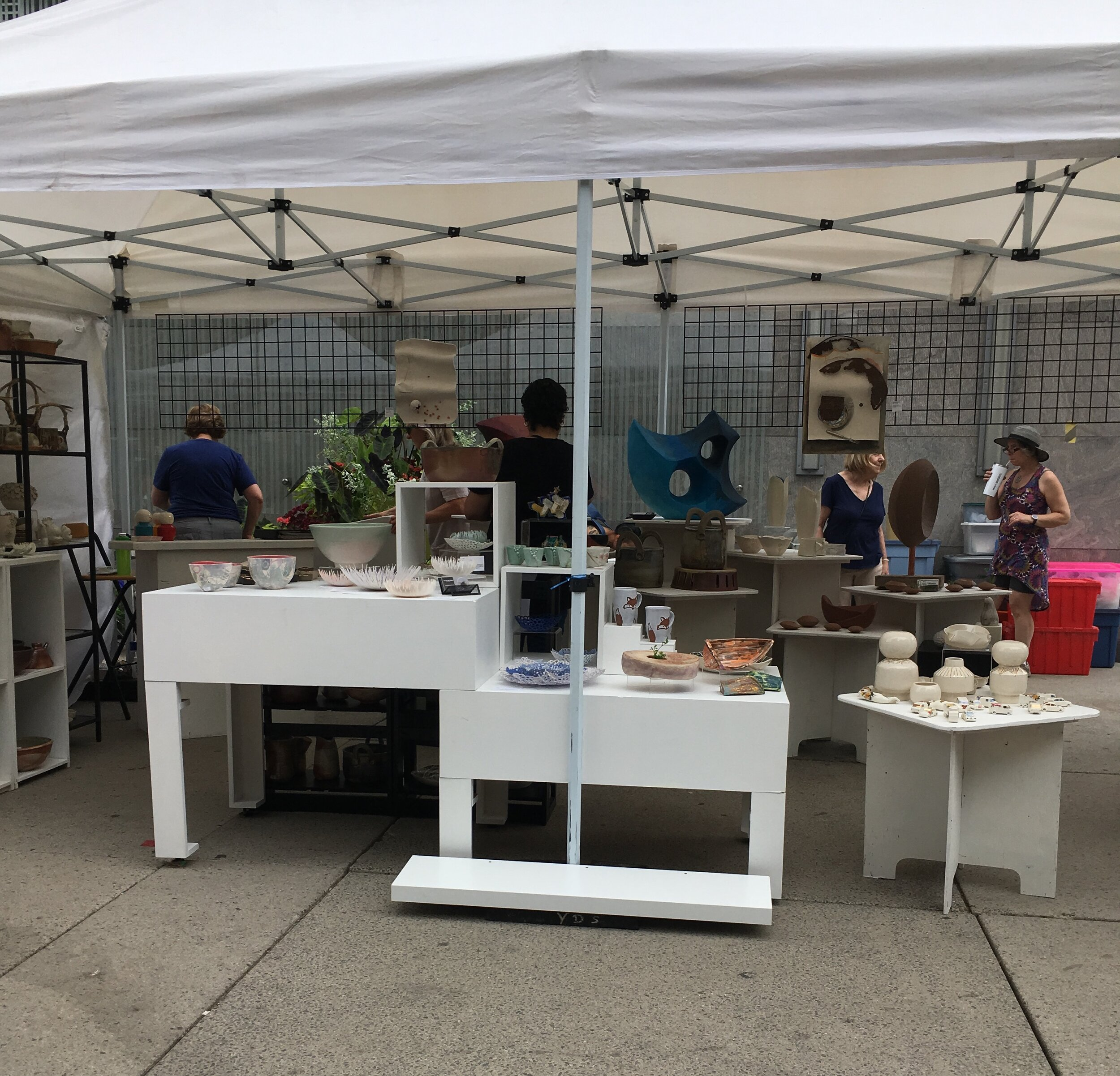 Toronto Potters tent set up for TOAF 2019 featuring the work of 11 potters.