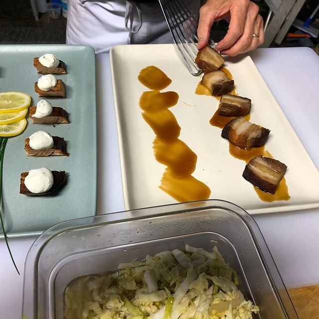 Pork belly with soy gastrique and spicy cabbage and smoked salmon with chive sour cream! Hungry? #cookingclass #cooking #visittuolumnecounty #industrialfoodworks