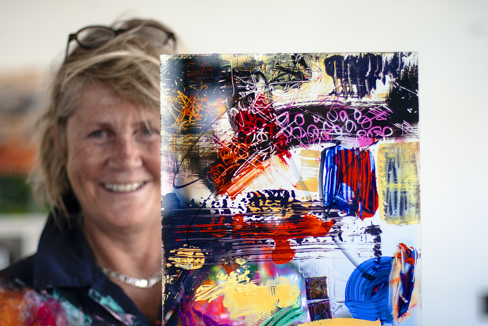 Red Dog artist Sally Coulden with one of her test paintings on perspex – front view