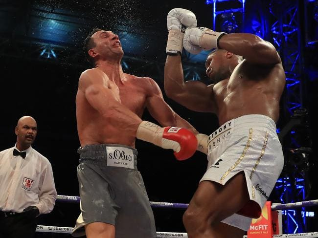Richard Heathcote captured Anthony Joshua stretching the neck of Wladimir Klitschko. Source:Getty Images