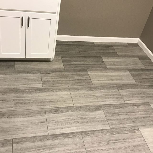 "Why tile? Installing GemCore is so much easier!  12""x24"" tiles built in our industry leading 70% stone composite construction. Tiles click into place to create an incredibly resilient, waterproof floor that looks unbelievable.  #compositeflooring #waterproofflooring #waterproof #SPC #stonecomposite #tile was #largeformattile #bathroomdesign #rewardflooring #realSPC #kidproof #petproof #partyproof #waterproof #wideplank #whytile?"