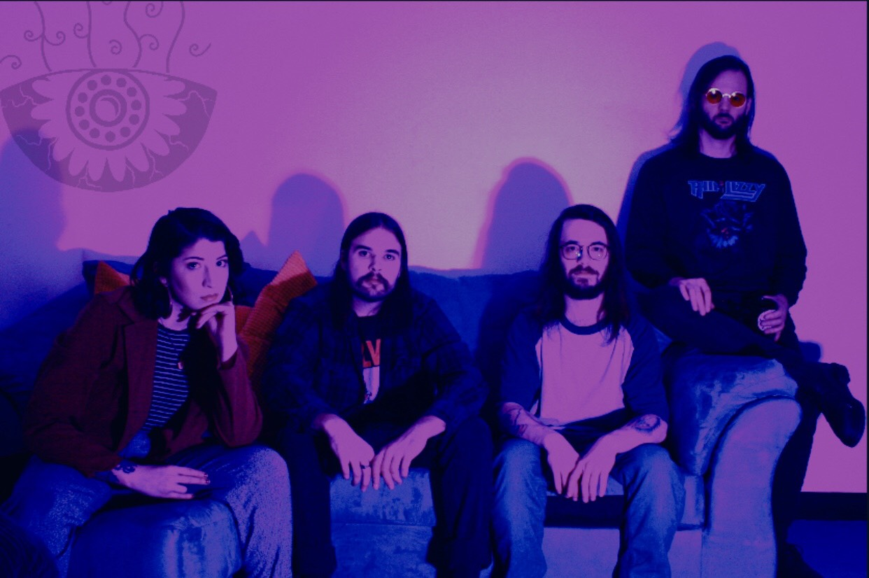The band consists of Violet on vocals, Chris on guitar, Mike on bass, and Ben on drums.