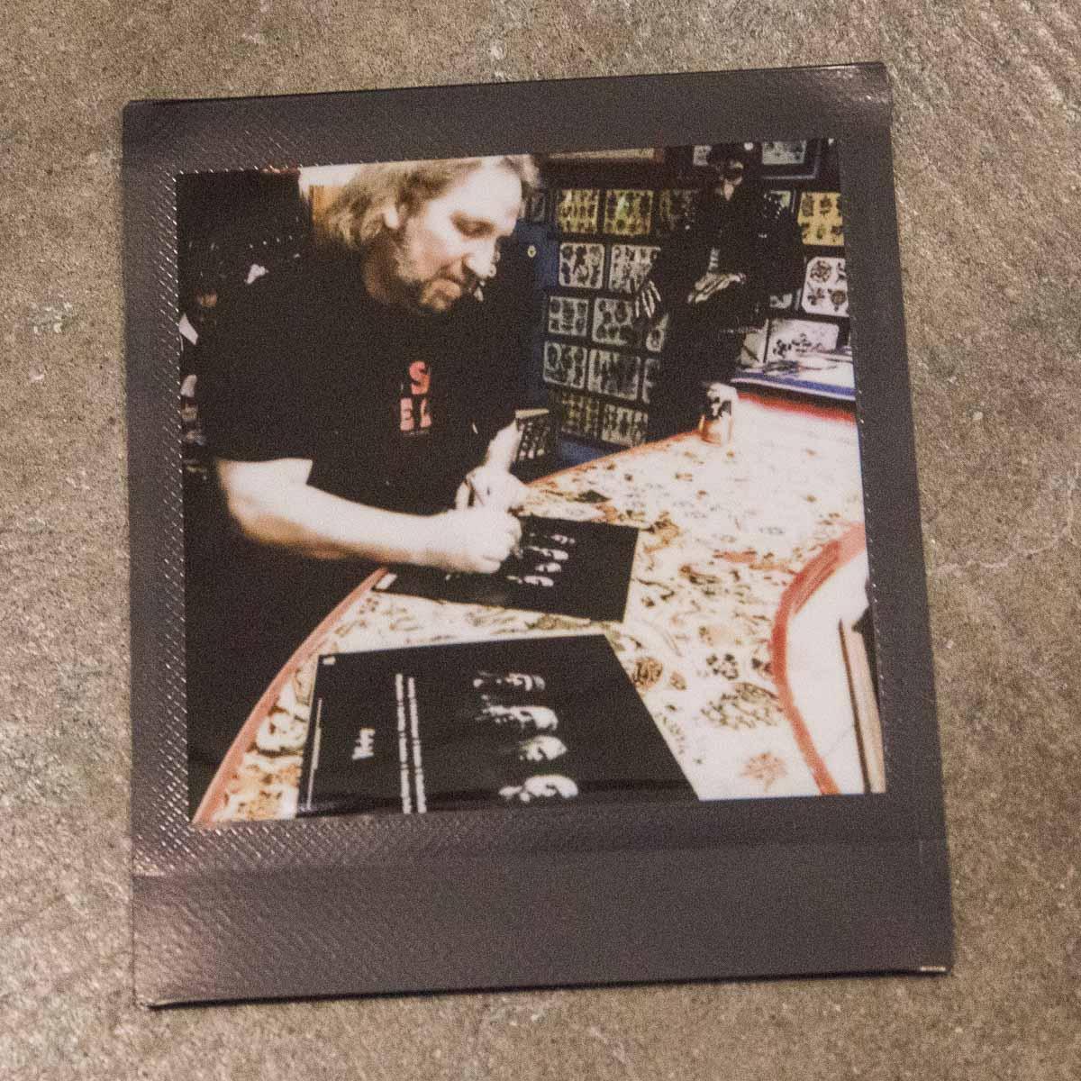 Phil Rind signing vinyls
