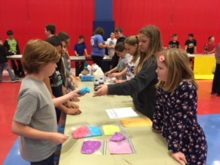 Students selling their product at market days.