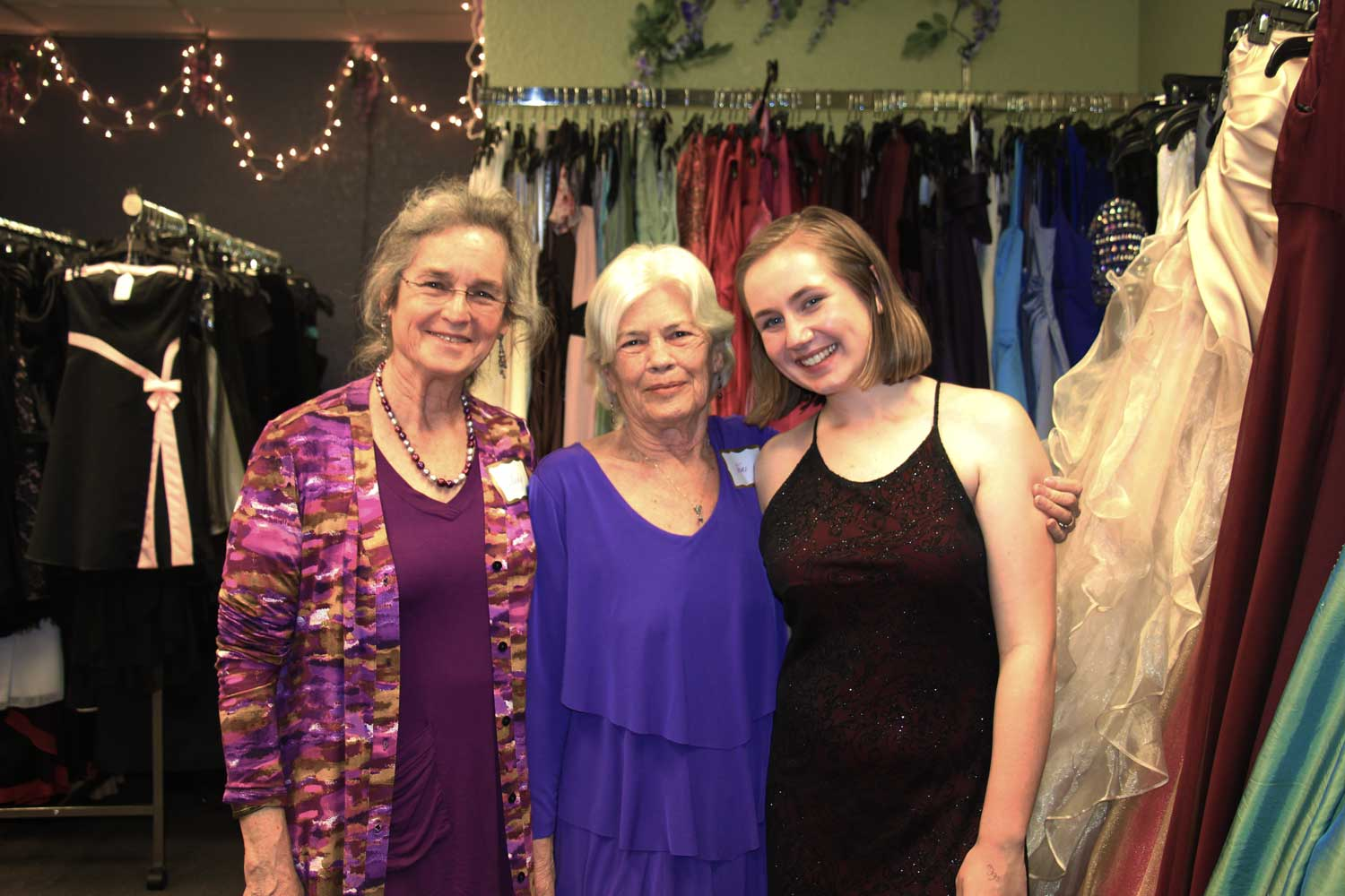 Teri Nelson, pictured center, founder.