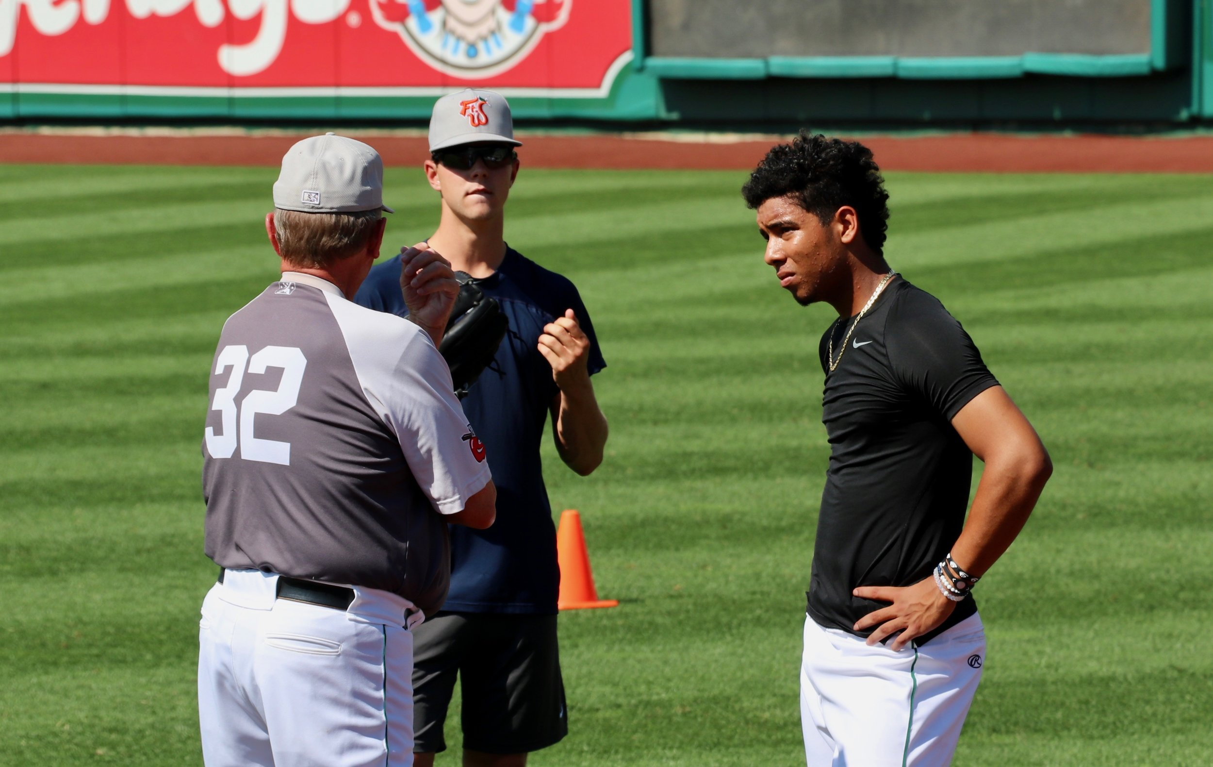 August 4, 2018. Burt Hooton, MacKenzie Gore and Luis Patiño (left to right) talk after Patiño's bullpen. Photo credit: Lance Brozdowski