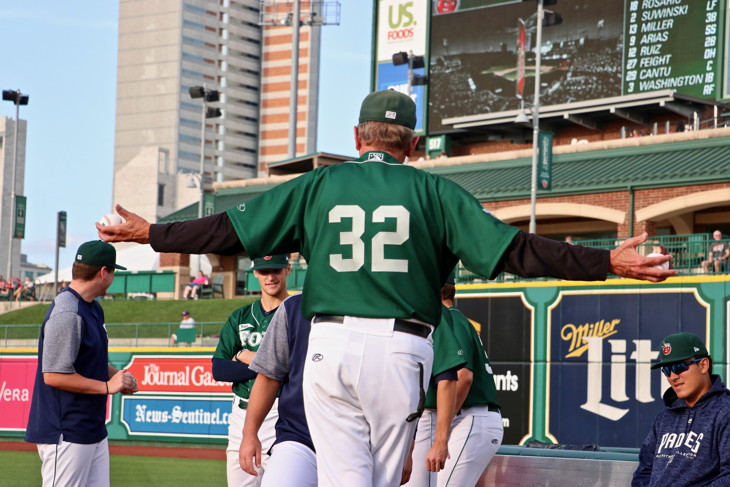 Burt Hooton standing on the Parkview Field bullpen mound in Fort Wayne, Indiana, holding two baseballs. Photo credit: Lance Brozdowski