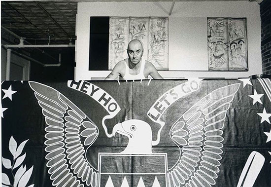 15.-Arturo-Vega-poses-with-a-banner-at-the-loft.jpg
