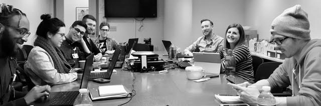 Left to right: Tim, Jaime, Fernando, Dennis, Sam, Michael, Ashley, Josh. (Note that Josh is working at digital outreach on his smart phone.)