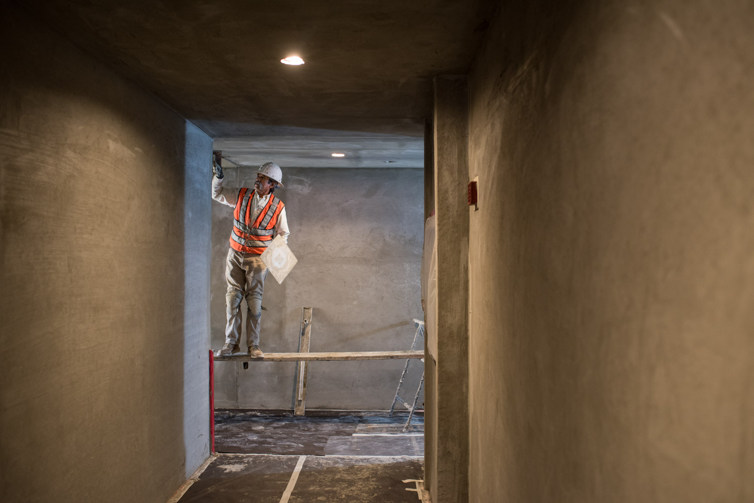 Nautilus General Contractor working on building interior, builder, construction photographer, contractor photography, lifestyle photography, lifestyle of architecture
