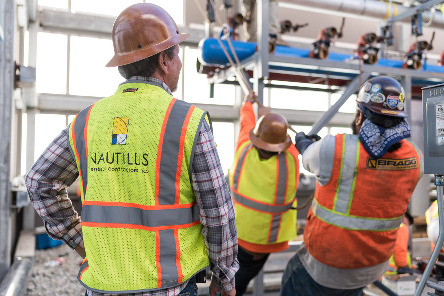 Contractors working on a high-rise building, architect photography, building photographer, commercial photography