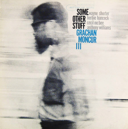 This album drives me crazy with how awesome the design is. This gorgeous, blurry black & white shot of Moncur and how the text stumbles down the back of his head and his shoulders. It's beautiful!