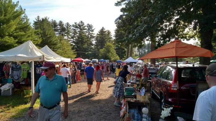 Buyers walk the path surrounded by sellers at the Hollis Flea Market. Image credit: internet source