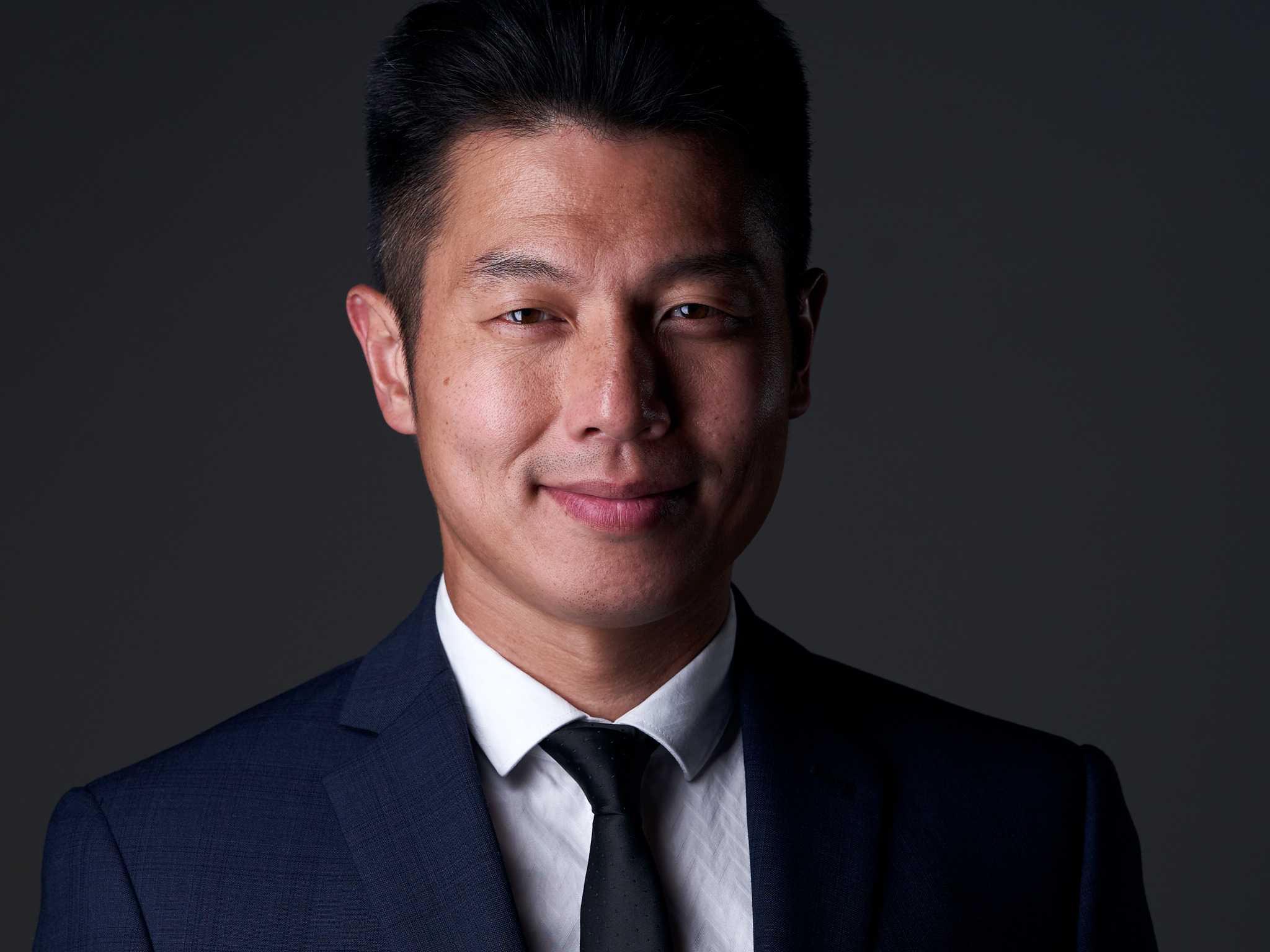 Asian male corporate headshot