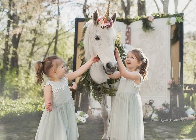 "These girls were the BEST unicorn wranglers. Saying ""giddy up"" and ""yah!!"" to Tinkerbell 😂 She did not giddy up, like the good unicorn she is 🙌🏻🦄😆 . Also? The wonder and joy on their faces. It's like Christmas in May 🤩 . Patient unicorn: @welshcreekfarmadventures  Magical location: @oakholmfarm  Greens/florals: @thesagebouquet"