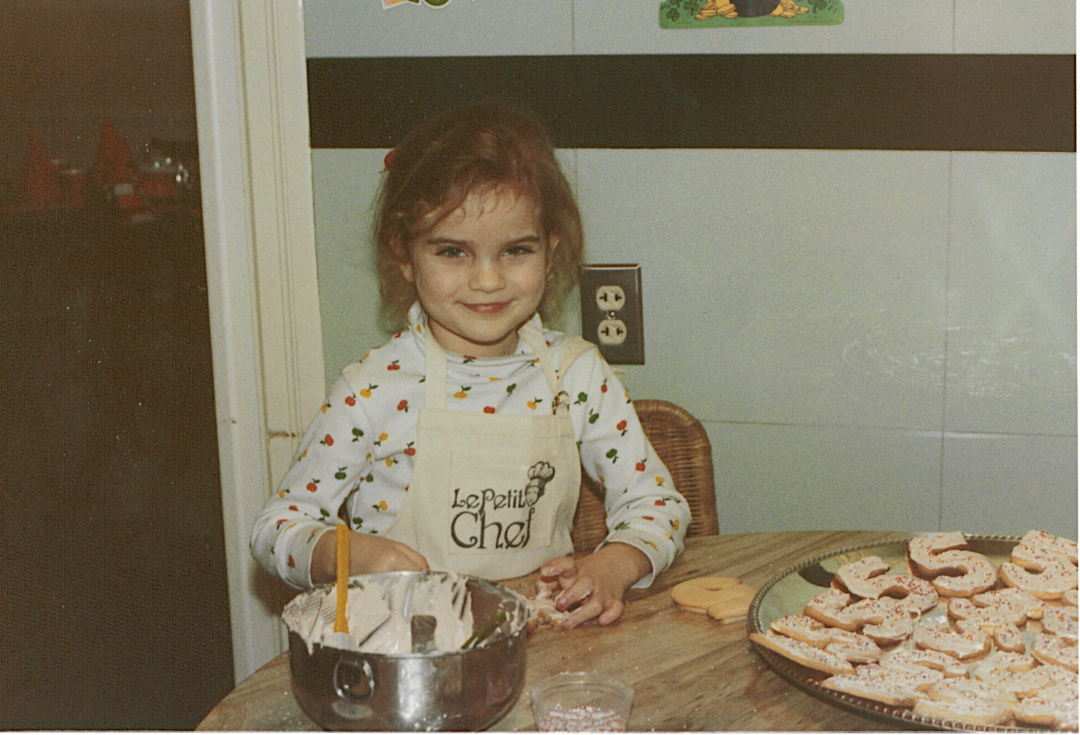 Decorating my fifth birthday sugar cookies, March 1983